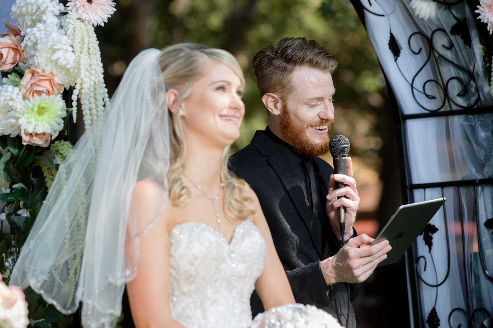 bride laughs with brother marrying