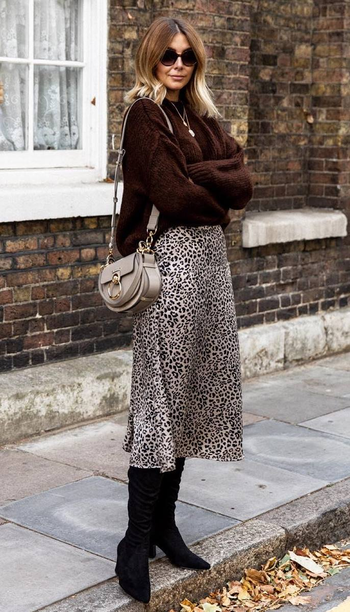 gorgeous outfit idea with a midi leopard skirt : bag + brown sweater + boots