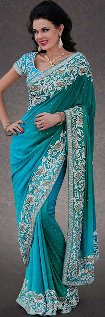Dreamy Variation on forms and shape compliment your style with Indian tradition. This Blue and Turquoise Georgette Indian Saree is beautifully designed with stylish embroidery and also in this Saree patch work is done with cutbeads and stone work.