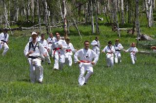 Colorado martial arts students running down a hill at a Taekwondo summer camp
