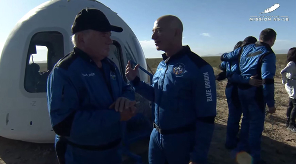 William Shatner confers with Blue Origin founder Jeff Bezos after the New Shepard capsule safely touched down at Launch Site One in Texas...on October 13, 2021.