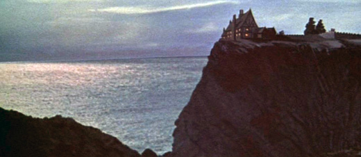 Establishing shot of the seaside hotel in War-Gods of the Deep (1965)