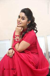 Actress Poorna Latest Stills in Red Dress at Rakshasi First Look Launch  0255.JPG