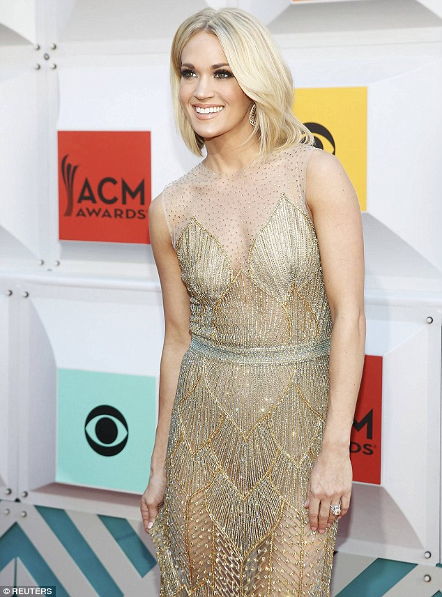 Carrie Underwood wears a sheer dress for the ACM Awards 2016