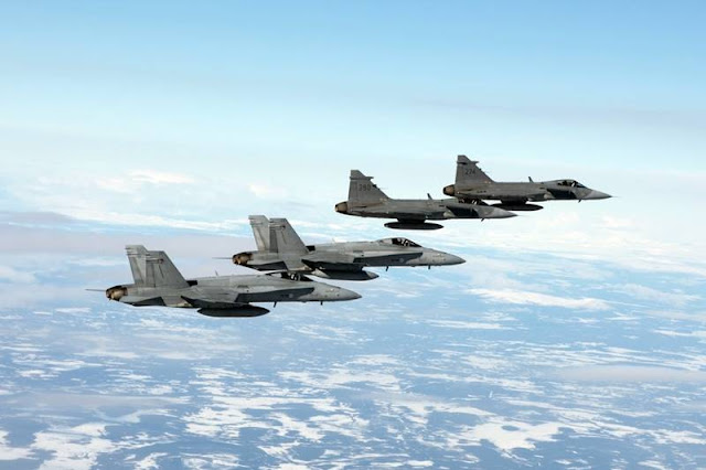 Finnish Hornets, Swedish Gripens train together in defense, attack activities