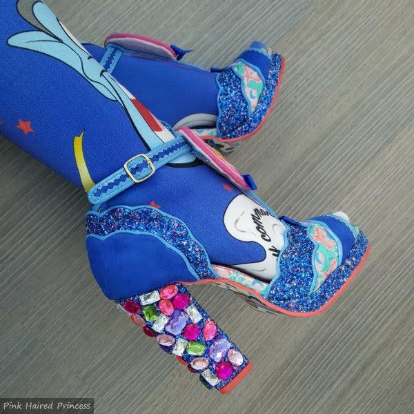 gem encrusted heel shoes in blue glitter with legs wearing Disney genie print tights