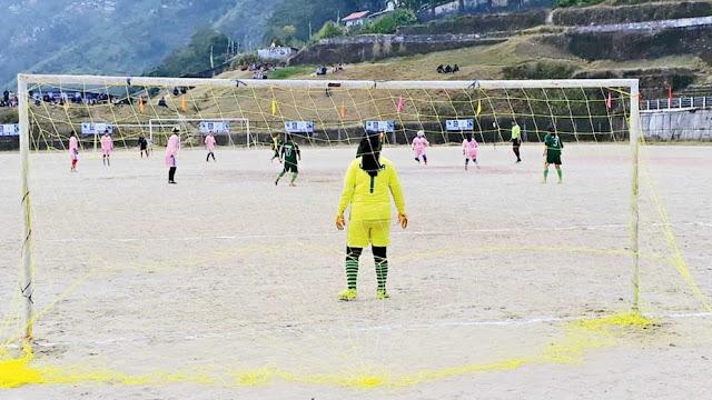 Women tea workers set goals in soccer arena