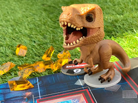 Tyrannosaurus figure with amber