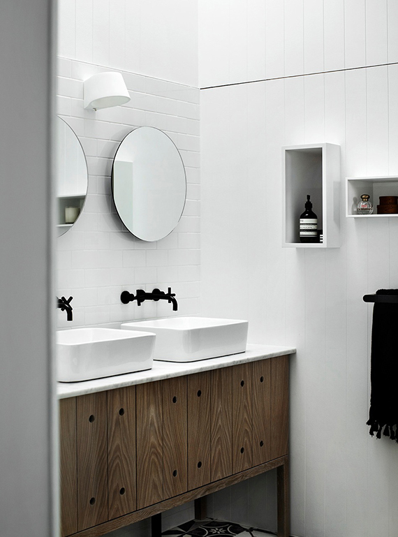 Black fixtures in the bathroom | Bathroom designed by Whiting Architects.