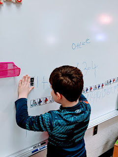 writing on white board  for math centers teach magically