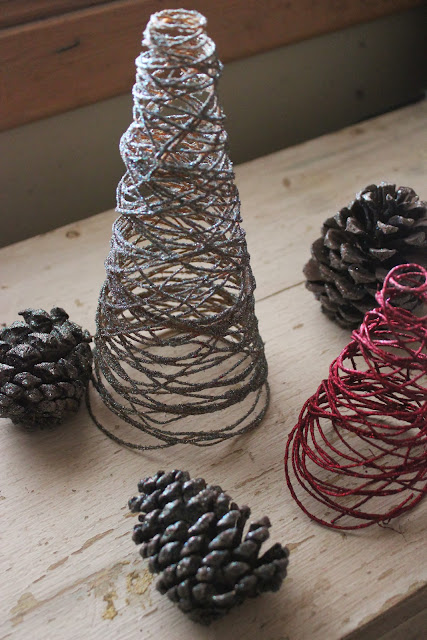 Make beautiful glitter trees for your mantel or shelf this holiday using just a few affordable supplies!