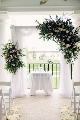 lake nona country club balcony wedding arch with flowers