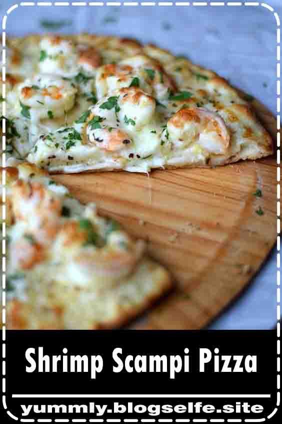 Shrimp Scampi Pizza topped with a light garlic-lemon sauce, shrimp, and cheeses #recipe #healthyrecipe #pizza #shrimp #scampi
