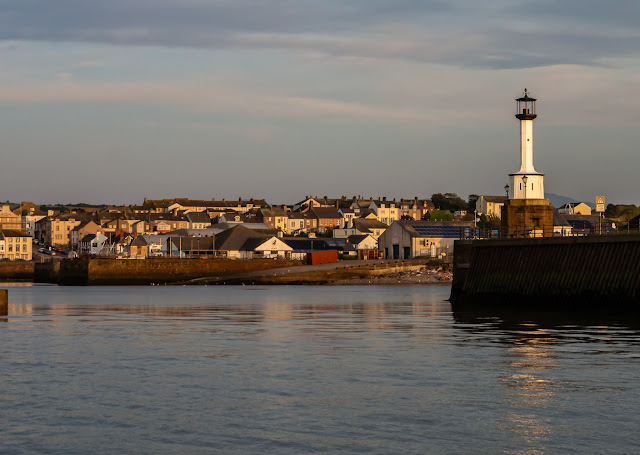 Photo ofo Maryport Lighthouse and the town in the evening sunshine