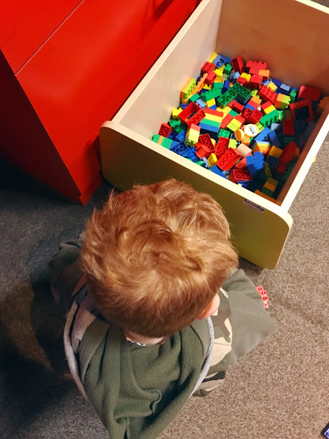Boy playing with Duplo