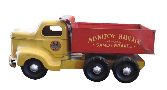 A steel minnitoy truck in red and yellow with the sand and gravel logo on the dump; these toys were produced in Orillia, Ontario by Otaco.