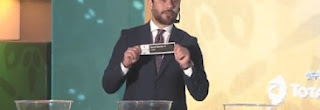اللاعب المصرى أحمد حسن يسحب قرعة دورى أبطال إفريقيا