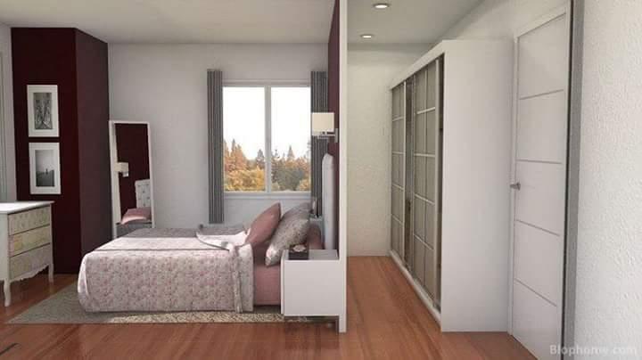 خزانة ملابس خلف سرير النوم