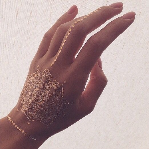 Attractive Gold Tattoo on Hand