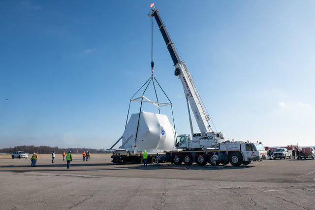 The Orion spacecraft being lifted onto the truck for transport to NASA's Plum Brook Station