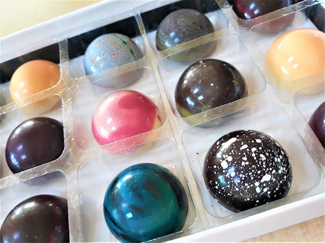 A box of discovery chocolate which include 9 different chocolates all inspired by different counties