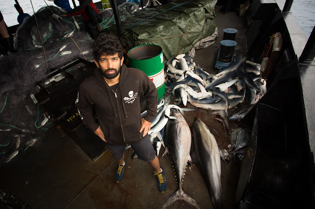 The writer with some of the species found in illegal driftnets. Credit: Sea Shepherd Global/Tim Watters