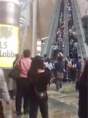 Watch the moment an Escalator malfunctions and starts running backwards, leaving 18 injured in a Hong Kong Mall
