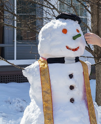 snowman dressed as a priest