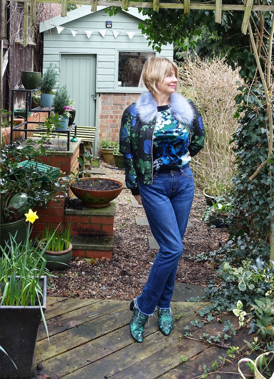 Over 50s style blogger Gail Hanlon in faux fur trimmed floral bomber jacket and jeans for the Style Not Age challenge Flower Power