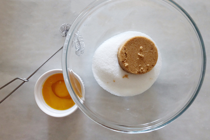 sugars in a bowl with eggs nearby