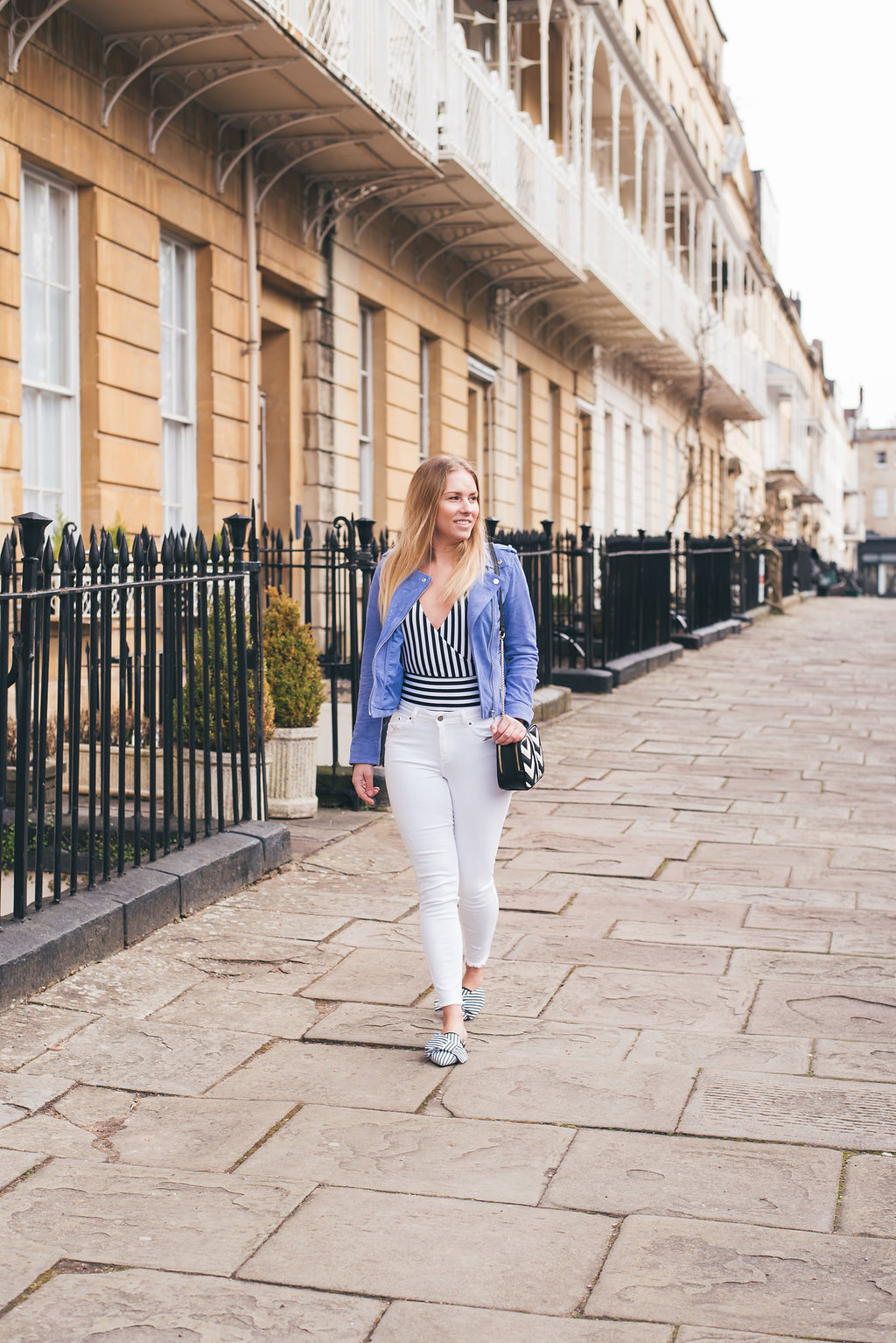 Striped outfit shot walking along the streets of bristol