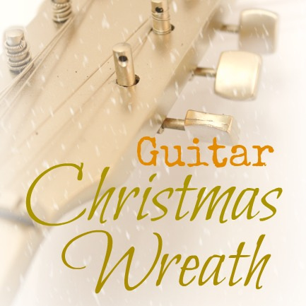 An old child's guitar turned into a Christmas wreath