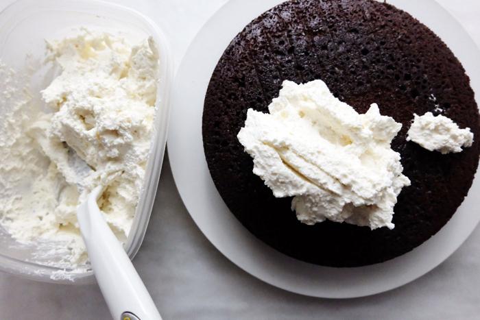 layering cream filling on cake round