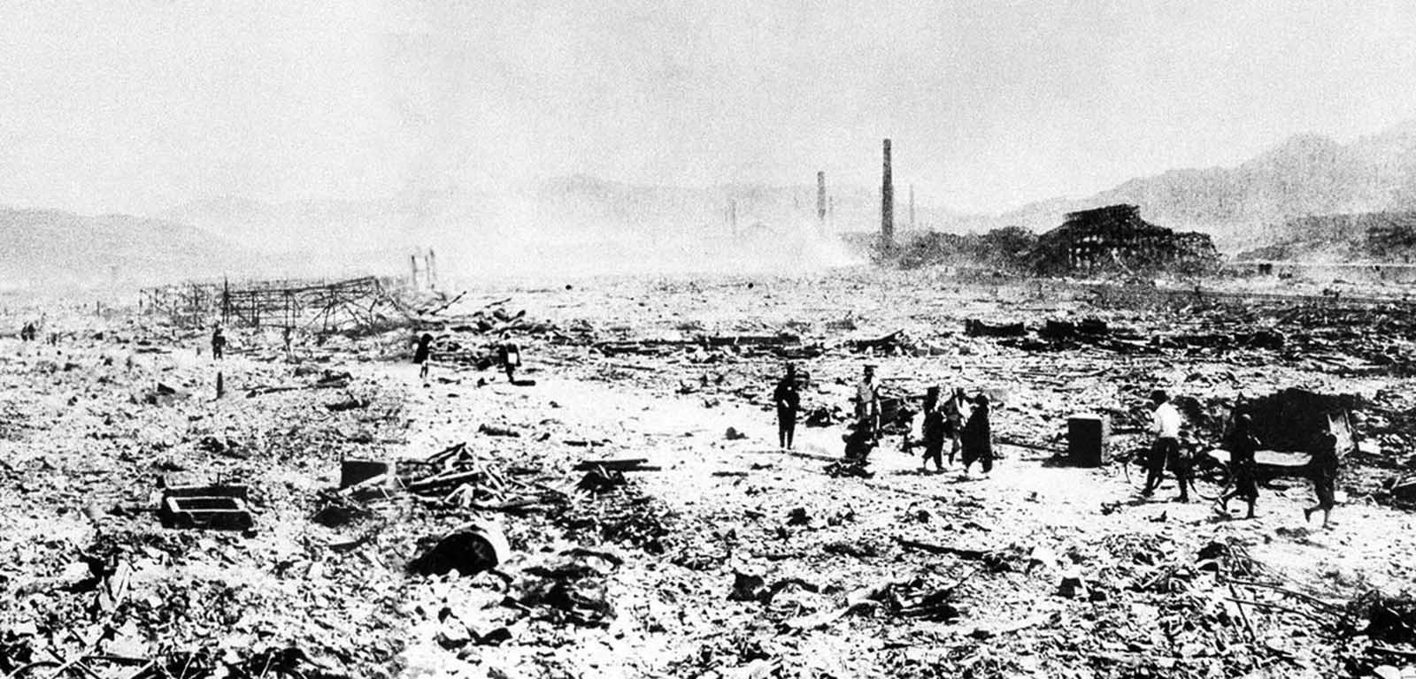 This picture made shortly after the August 9, 1945 atomic bombing, shows workers carrying away debris in a devastated area of Nagasaki, Japan. This picture obtained by the U.S. Army from files of Domei, the official Japanese news agency, was the first ground view of the nuclear destruction in Nagasaki.