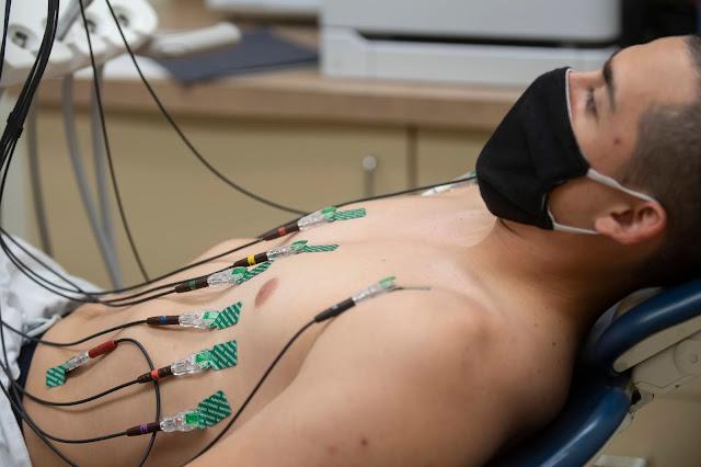 A man receives an electrocardiogram.
