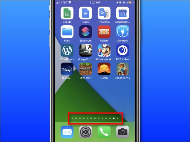 تظهر صفحة الشاشة الرئيسية أعلى Dock على iPhone.
