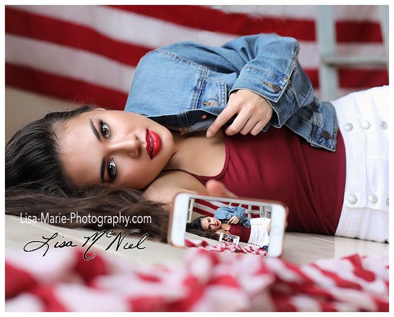 Asian girl with American flag and cell phone
