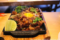 Sizzling Sisig: Pork Head, Chili, Whole Egg at Pig & Khao