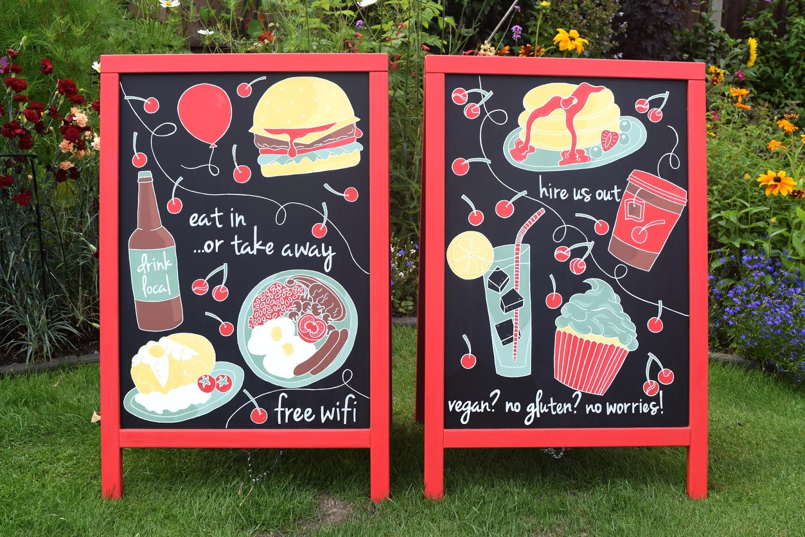 painted boards for a cafe with food illustrations