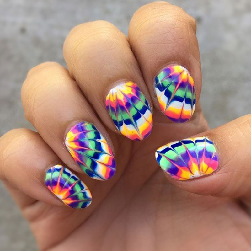 10 Groovy Tie-Dye Nail Looks That Everyone Needs To Try