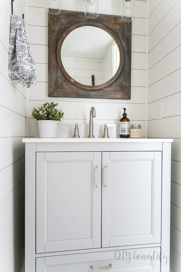 gray and white bathroom with rustic farmhouse decor