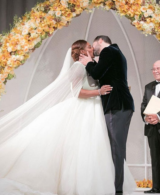 Serena Williams gets loving kisses from her new husband Alexis Ohanian at their wedding..