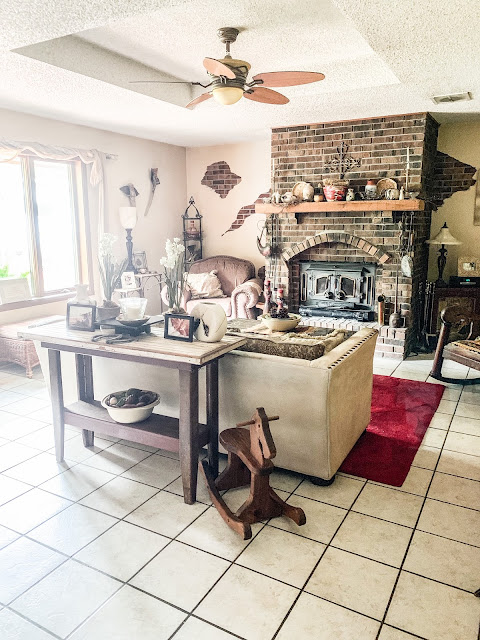 large brick fireplace with neutral decor
