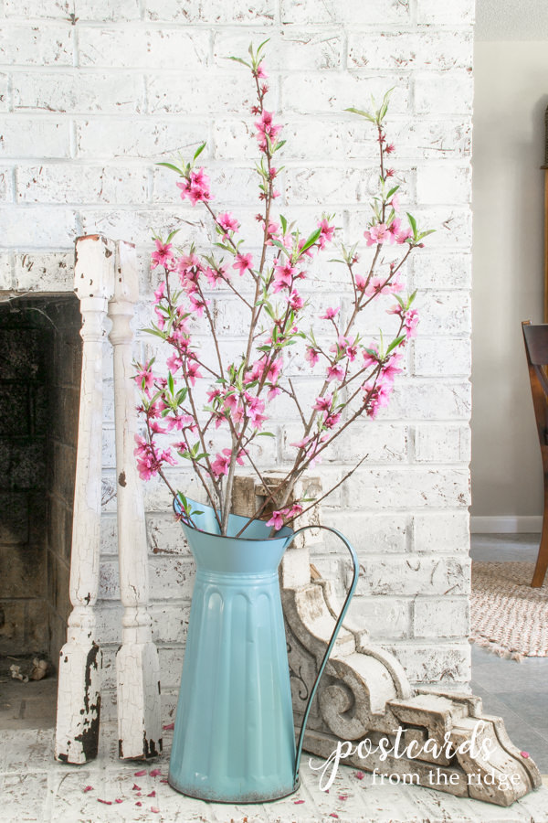 blue pitcher with peach blossoms and salvaged spindles and corbel