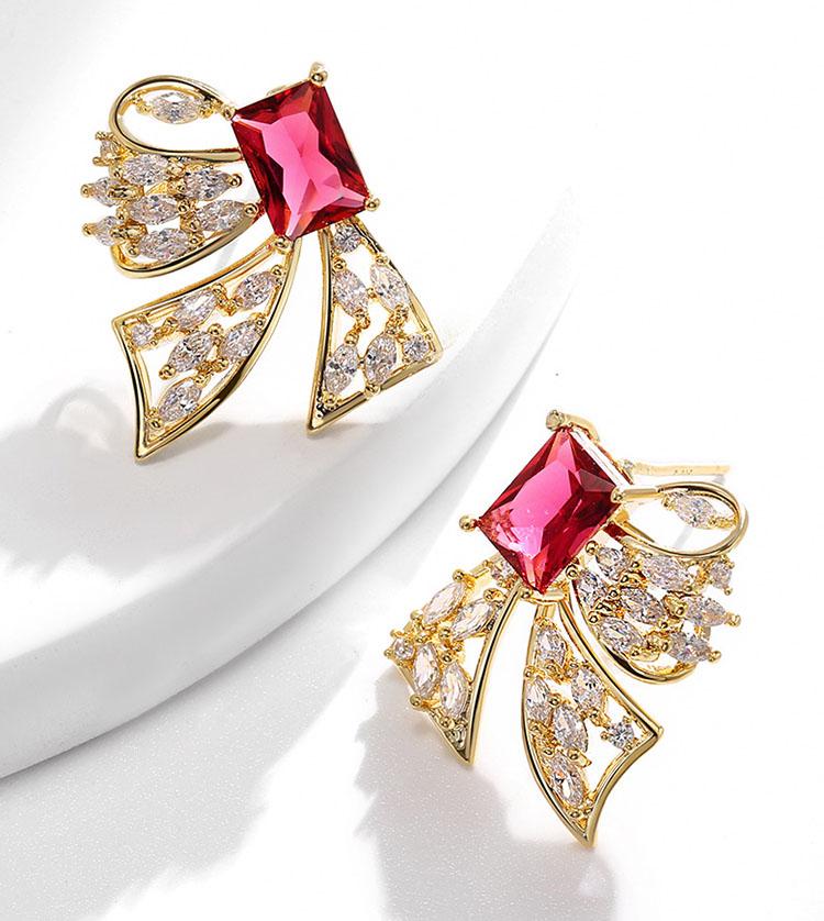 不對稱風甜心蝴蝶結水晶耳環