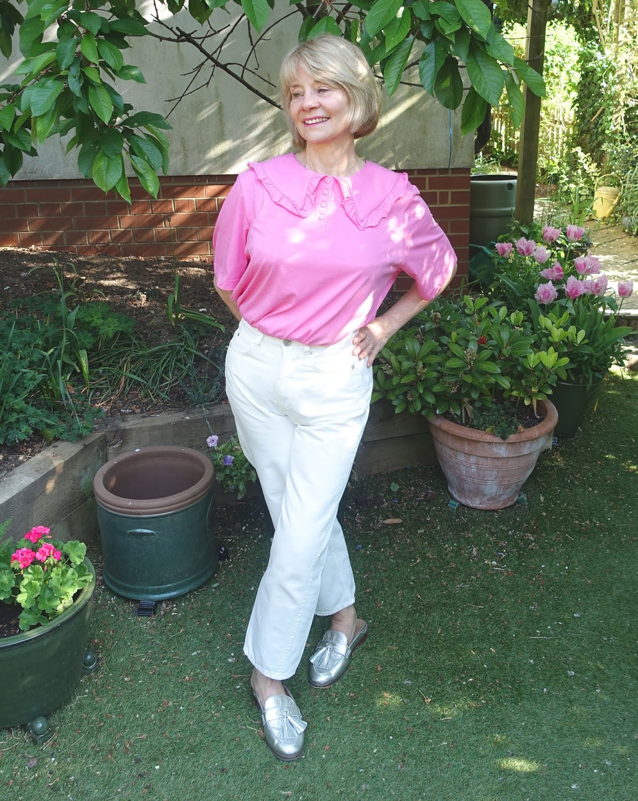 Pink statement collar top and white jeans worn by over 50s style blogger Gail Hanlon from Is This Mutton?