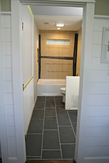 Bathroom with dark gray floor tile