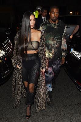 Kim Kardashian slips into bizarre boob tube and trouser ensemble while Kourtney is seriously sexy in lingerie look