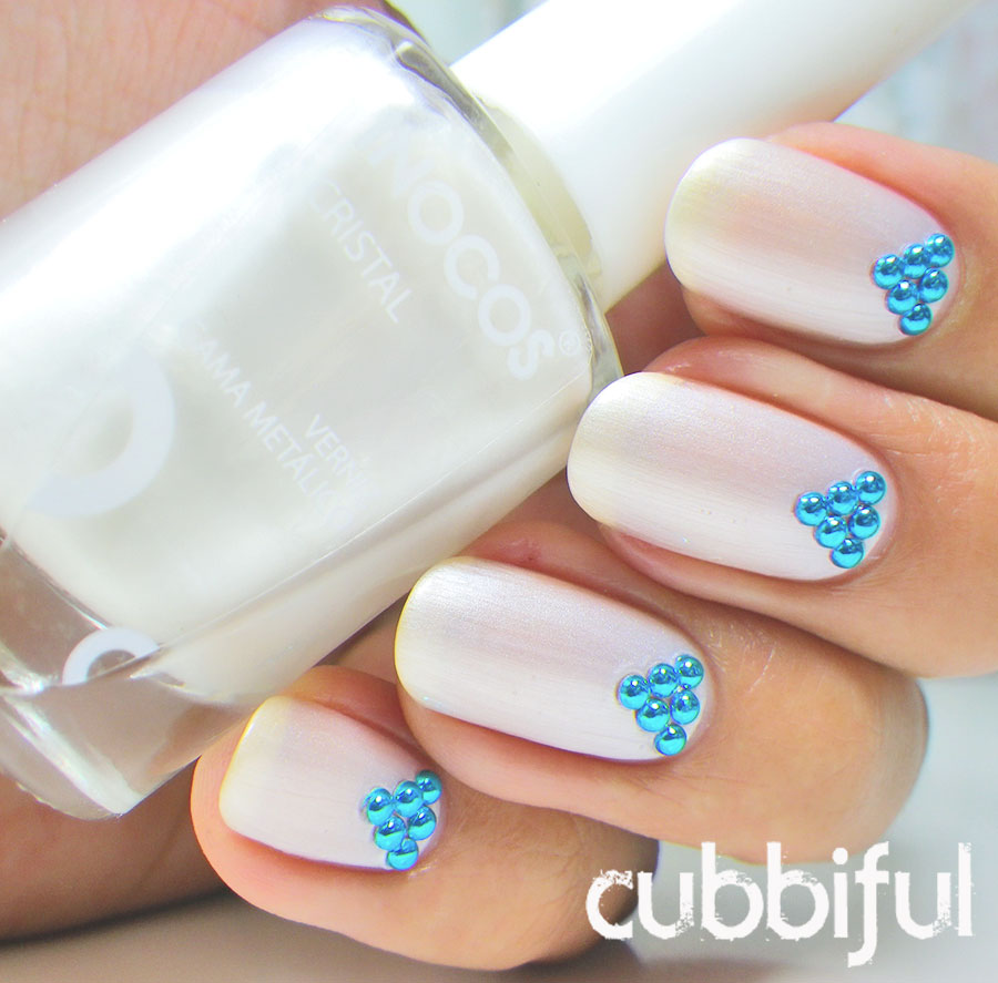 elegant pearly white nails with studs using Inocos