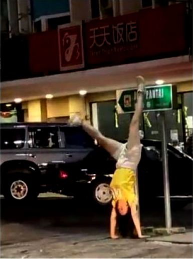 Uproar over Chinese women seen doing handstands in Malaysian tourist street, mosque
